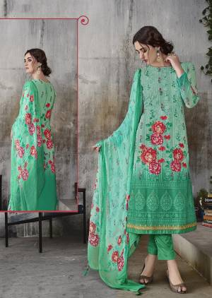 Simple And Elegant Designer Suit Is Here In Lakhnavi Work with Digital Prints. This Suit Is In All Over Sea Green Color Whose Top Is Georgette Based Paired With Santoon Bottom And Chiffon Fabricated Dupatta.