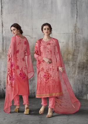 Flaunt Your Rich And Elegant Taste Wearing This Designer Straight Suit In Dark Peach Color. Its Top IS Fabricated on Georgette Beautified With Lakhnavi Work And Digital Prints, Paired With Santoon Bottom And Chiffon Fabricated Dupatta.