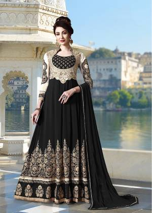 Get Ready For The Upcoming Festive And Wedding Season With This Heavy Designer Floor Length Suit In Black Color. Its Heavy Embroidered Top Is Fabricated On Georgette Paired With Santoon Bottom and Chiffon Fabricated Dupatta. All Its Fabrics Ensures Superb Comfort Throughout The Gala. Buy Now.