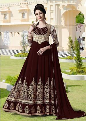 Get Ready For The Upcoming Festive And Wedding Season With This Heavy Designer Floor Length Suit In Maroon Color. Its Heavy Embroidered Top Is Fabricated On Georgette Paired With Santoon Bottom and Chiffon Fabricated Dupatta. All Its Fabrics Ensures Superb Comfort Throughout The Gala. Buy Now.