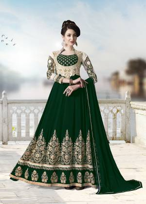 Get Ready For The Upcoming Festive And Wedding Season With This Heavy Designer Floor Length Suit In Dark Green Color. Its Heavy Embroidered Top Is Fabricated On Georgette Paired With Santoon Bottom and Chiffon Fabricated Dupatta. All Its Fabrics Ensures Superb Comfort Throughout The Gala. Buy Now.