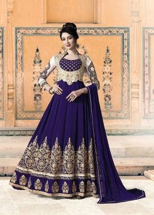 Get Ready For The Upcoming Festive And Wedding Season With This Heavy Designer Floor Length Suit In Royal Blue Color. Its Heavy Embroidered Top Is Fabricated On Georgette Paired With Santoon Bottom and Chiffon Fabricated Dupatta. All Its Fabrics Ensures Superb Comfort Throughout The Gala. Buy Now.