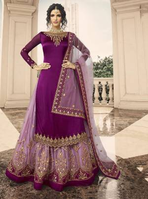 Shine Bright Wearing This Designer Lehenga Suit In Purple Colored Top Paired With Lilac Colored Lehenga And Dupatta. Its Top Is Fabricated On Satin Georgette Paired With Net Lehenga And Dupatta.