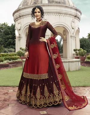 This Wedding Season Be The Most Unique One Wearing This Indo-Western Lehenga Suit In Maroon And Red Color. Its Top Is Fabricated On Satin Georgette Paired With Georgette Lehenga And Net Fabricated Dupatta. Its Top, Bottom And Dupatta aRe Beautified With Heavy Embroidery Work.