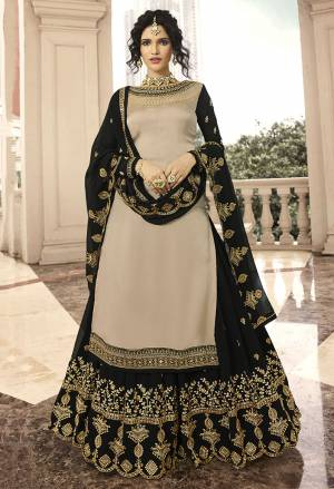 Flaunt Your Rich And Elegant Taste With Such Design And Elegant Color Pallete. Grab This Indo Western Lehenga Suit In Sand Beige Colored Top Paired With Black Colored Lehenga and Dupatta. Its Top Is Fabricated On Satin Georgette Paired With Georgette Fabricated Lehenga And Dupatta.