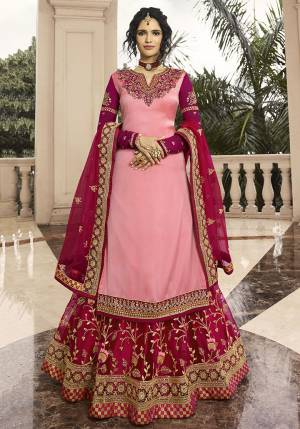Go With The Shades Of Pretty Pink With This Designer Indo-Western Lehenga Suit In Pink Colored Top Paired With Rani Pink Colored Lehenga And Dupatta. Its Top Is Fabricated On Satin Georgette Paired With Net Fabricated Lehenga And Dupatta. Buy Now.