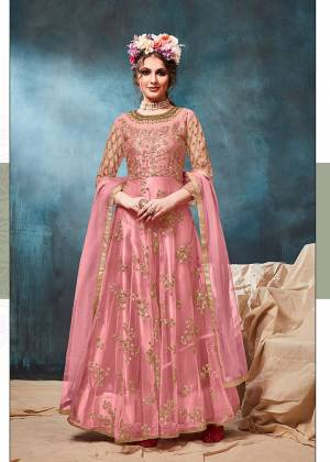 Get Ready For The Upcoming Wedding And Festive Season With This Heavy Designer Floor Length Suit In Pink Color. Its Heavy Embroidered op Is Fabricated On Net Paired With Santoon Bottom And Net Fabricated Dupatta. Buy Now.