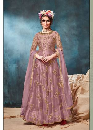 Get Ready For The Upcoming Wedding And Festive Season With This Heavy Designer Floor Length Suit In Mauve Color. Its Heavy Embroidered op Is Fabricated On Net Paired With Santoon Bottom And Net Fabricated Dupatta. Buy Now.