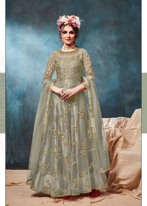 Get Ready For The Upcoming Wedding And Festive Season With This Heavy Designer Floor Length Suit In Mint Green Color. Its Heavy Embroidered op Is Fabricated On Net Paired With Santoon Bottom And Net Fabricated Dupatta. Buy Now.