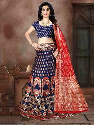 This Festive Season Have A Proper Traditional Look Wearing This Silk Based Lehenga Choli In Navy Blue Color Paired With Contrasting Red Colored Dupatta. This Lehenga Choli Is Fabricated On Banarasi Jacquard Silk Beautified With Weave All Over.