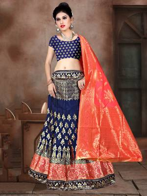 Look Pretty In This Designer Silk Based Lehenga Choli In Navy Blue Color Paired With Contrasting Fuschia Pink Colored Dupatta. It Is Fabricated On Banarasi Jacquard Silk Beautified With Weave All Over. Buy This Pretty Piece Now.