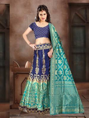 Go With Pretty Shades Of Blue Wearing This Heavy Weaved Designer Lehenga Choli In Navy Blue Color Paired With Blue Colored Dupatta. Its Blouse Is Fabricated On Banarasi Art Silk Paired With Banarasi Jacquard Silk  Lehenga And Dupatta.