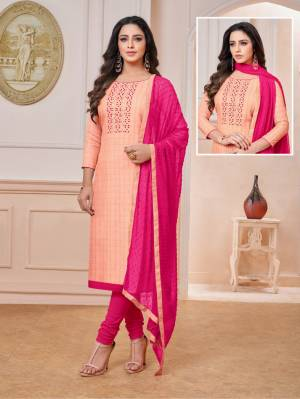 Here Is a Very Pretty Color Pallete With This Designer Dress Material In Peach Colored Top Paired with Contrasting Dark Pink Colored Bottom And Dupatta. Its Top Checks Top IS Rayon Based Paired With Cotton Bottom And Chiffon Fabricated Dupatta.