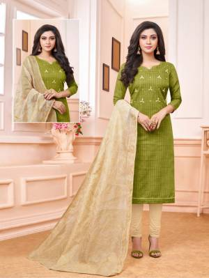 Enhance Your Personality Wearing This Designer Staright Suit In Green Colored Top Paired With Cream Colored Bottom And Dupatta. Its Top And Bottom Are Cotton Based Paired With Embroidered Cotton Silk Dupatta.