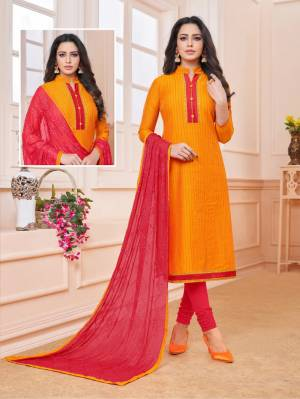 Add Some Semi-Casuals To Your Wardrobe With This Designer Straight Suit In Orange Colored Top Paired With Contrasting Dark Pink Colored Bottom And Dupatta. This Dress Material IS Cotton Based Paired With Chiffon Fabricated Embroidered Dupatta. Buy Now.