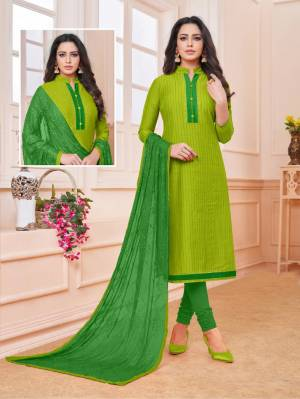 Add Some Semi-Casuals To Your Wardrobe With This Designer Straight Suit In Parrot Green Colored Top Paired With Green Colored Bottom And Dupatta. This Dress Material IS Cotton Based Paired With Chiffon Fabricated Embroidered Dupatta. Buy Now.