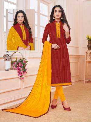 Add Some Semi-Casuals To Your Wardrobe With This Designer Straight Suit In Maroon Colored Top Paired With Contrasting Musturd Yellow Colored Bottom And Dupatta. This Dress Material IS Cotton Based Paired With Chiffon Fabricated Embroidered Dupatta. Buy Now.