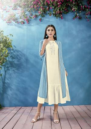Pretty Elegant Looking Designer Readymade Kurti With Jacket Is Here In White And Blue Color. This Pretty Thread Embroidered Kurti Is Fabricated On Cotton Paired With Handloom Cotton Fabricated Printed Jacket.