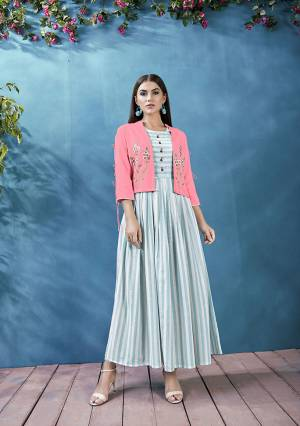 This Festive Season Celebrate With Beauty And Comfort Wearing This Readymade Kurti In Light Blue And White Color Paired With Pink Colored Jacket. This Pretty Lining Printed Kurti Is Fabricated On Handloom Cotton Paired With Rayon Fabricated Embroidered Jacket. Buy Now.