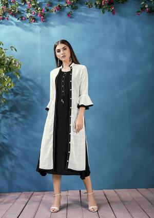 For A Bold and Beautiful Look Grab This Designer Readymade Kurti In Black Color Which Comes With A White Colored Jacket. This Plain Kurti IS Rayon Based Paired With Handloom Cotton Fabricated Thread Embroidered Jacket.