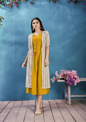 Celebrate This Festive Season With Beauty And Comfort Wearing This Readymade Deisgner Kurti In Musturd Yellow Color Paired With Beige And White Colored Jacket. Its Kurti Is Rayon Based paired With Handloom Cotton fabricated Jacket. Buy Now.