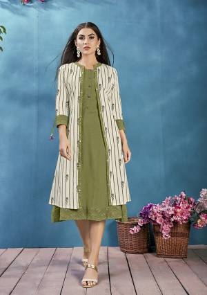 Add This Pretty Readymade Kurti To Your Wardrobe In Olive Green Color Paired With Off-White Colored Jacket, This Kurti and Jacket Are Cotton Based Beautified With Prints And Thread Work.