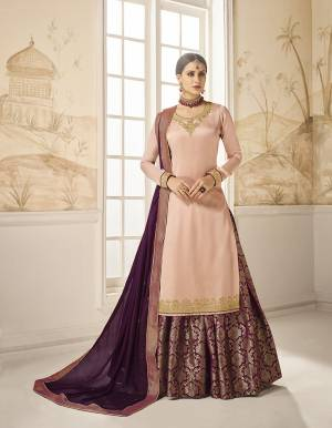 Choose Your Indo-Western Style As Per Occasion And You Can Get Its Bottom Stitched As Skirt Or Plazzo. Its Pretty Top Is In Pink Color Paired With Contrasting Purple Colored Bottom And Dupatta. Its Top Is Fabricated On Satin Silk Paired With Jacquard Silk Bottom And Georgette Silk Fabricated Dupatta. Buy This Lovely Designer Piece Now.