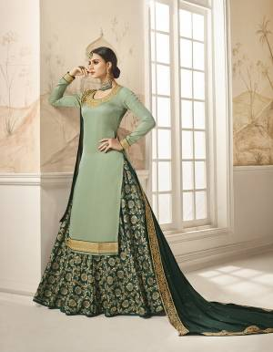 Flaunt Your Rich And Elegant Taste Wearing This Designer Indo-Western Suit In Light Green Colored Top Paired With Pine Green Colored Bottom And Dupatta. Its Embroidered Top Is Fabricated On Satin Silk Paired With Jacquard Silk Bottom And Georgette Silk Fabricated Dupatta. As Per Your Choice You Can Its Bottom Stitched As A Plazzo Or Skirt.