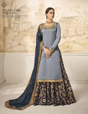Choose Your Indo-Western Style As Per Occasion And You Can Get Its Bottom Stitched As Skirt Or Plazzo. Its Pretty Top Is In Steel Blue Color Paired With Navy Blue Colored Bottom And Dupatta. Its Top Is Fabricated On Satin Silk Paired With Jacquard Silk Bottom And Georgette Silk Fabricated Dupatta. Buy This Lovely Designer Piece Now.