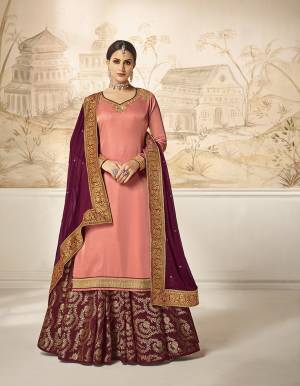 Flaunt Your Rich And Elegant Taste Wearing This Designer Indo-Western Suit In Dark Peach Colored Top Paired With Contrasting Magenta Pink Colored Bottom And Dupatta. Its Embroidered Top Is Fabricated On Satin Silk Paired With Jacquard Silk Bottom And Georgette Silk Fabricated Dupatta. As Per Your Choice You Can Its Bottom Stitched As A Plazzo Or Skirt.