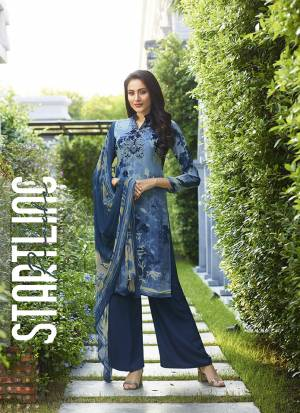 For Your Semi-Casuals, Grab This Pretty Straight Suit In Blue Color. Its Top And Bottom Are Fabricated On Crepe Paired With Georgette Fabricated Dupatta. Buy This Dress Material Now.