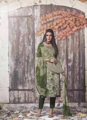Beat The Heat This Summer Wearing This Simple and Elegant looking Printed Straight Suit In Olive Green Color. This Dress Material Is Fabricated On Crepe Paired With Georgette Fabricated Dupatta. Buy This Pretty Digital Printed Suit Now.