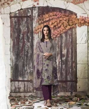 Grab This Pretty Digital Printed Dress Material In Grey And Purple Color. Its Top And Bottom Are Fabricated On Crepe Paired With Georgette Fabricated Dupatta. Get This Stitched As Per Your Desired Fit And Comfort.