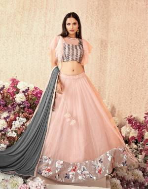 Feminine and frilly lehenga in the most beautiful shade of pink and hints of floral details makes this lehenga a piece that's wow-worthy. Pair it with swarvoski jewels for a classy appeal.