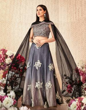A shimmery and stylish cape sleeved lehenga in the most attarctive ombre shade will make the onlookers swoon with praise. Opt for a sleek hairdo and natural makeup to look a class apart.