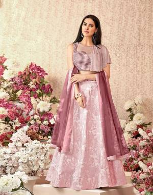 Here Is A subtle, simple and dreamy pink lehenga paired with a stylish assymetric draped blouse will take your fashion  nuances a step higher. Opt for statement fashion jewelry to look ethereal.