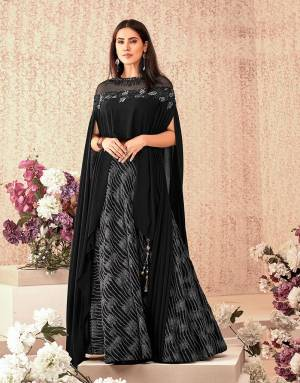 This black cocktail-lehenga with a cape blouse is alluring and artistic at the same time. Keep the look fresh and minmal to enhance the beauty of the outfit.