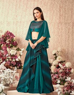 A design with asymetric cuts and bell sleeve blouse in the most gorgeous shade of teal ticks all the right boxes of fashion . Use the dupatta or go sans dupatta and look trendy