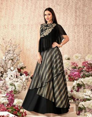 When you dream of a lehenga that's girlish , unique and at its stylish best, this design is the one for you, With a frill addition to the blouse, it makes for a wonderful pick .