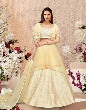 A modest pick for this festive season, this cream lehenga will make you look dreamy with its meticulous details and cuts. Pair with beautiful fashion earrings to complete the look.