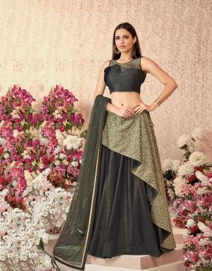 This remarkably stylish lehenga with a one-side asymmetric layer and a handwork detailed blouse is for the refined tastes.