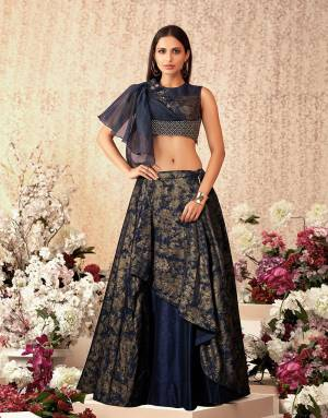 Pretty, polished and full of stylish cuts, this navy blue lehenga is perfect fit for the bridemaids who which to stand out. Add stylish hoop earrings to complete the look.