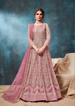 Grab This Very Beautiful and Attractive Looking Heavy Designer Floor Length Suit In Pink Color. Its Top And Dupatta Are Fabricated On Net Beautified With Coding Work Paired With Santoon Fabricated Bottom. It Is Prefectly Suitable For The Wedding And Festive Season. Buy Now.