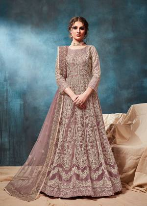 Grab This Very Beautiful and Attractive Looking Heavy Designer Floor Length Suit In Mauve Color. Its Top And Dupatta Are Fabricated On Net Beautified With Coding Work Paired With Santoon Fabricated Bottom. It Is Prefectly Suitable For The Wedding And Festive Season. Buy Now.