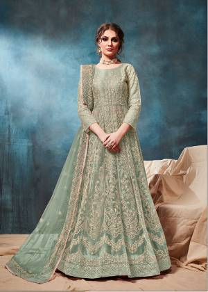 Grab This Very Beautiful and Attractive Looking Heavy Designer Floor Length Suit In Pastel Green Color. Its Top And Dupatta Are Fabricated On Net Beautified With Coding Work Paired With Santoon Fabricated Bottom. It Is Prefectly Suitable For The Wedding And Festive Season. Buy Now.