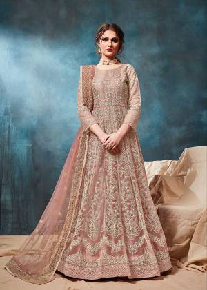 Grab This Very Beautiful and Attractive Looking Heavy Designer Floor Length Suit In Dusty Peach Color. Its Top And Dupatta Are Fabricated On Net Beautified With Coding Work Paired With Santoon Fabricated Bottom. It Is Prefectly Suitable For The Wedding And Festive Season. Buy Now.