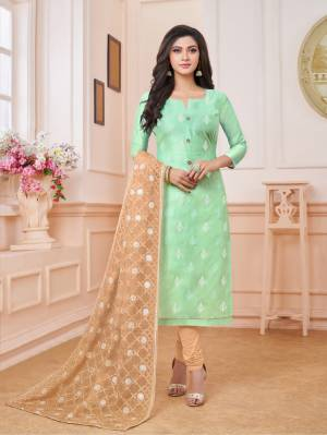 Celebrate This Festive Season Wearing This Designer Straight Suit In Light Green Colored Top Paired With Beige Colored Bottom And Dupatta. Its Top Is Fabricated On Modal Silk Paired With Cotton Bottom And Net Fabricated Dupatta. Its Top And Dupatta Are Beautified With Embroidery. Buy Now.