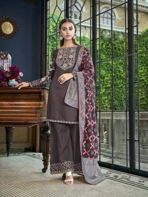 Add This Designer Piece To Your Wardrobe In Dark Grey Color Paired With Dark Grey And Multi Colored Dupatta. Its Embroidered Top And Bottom Are Fabricated On Satin Slub Paired With Jacquard Silk Fabricated Dupatta.