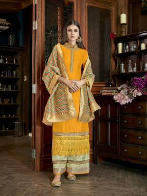 Celebrate This Festive Season With Beauty Comfort Wearing This Designer Plazzo Suit In Musturd Yellow Colored Top Paired With Contrasting Pastel Green Colored Bottom And Multi Colored Dupatta. Its Top And Bottom and Fabricated On Soft Silk Paired With Jacquard Silk Fabricated Dupatta.