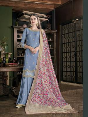 Here Is A Very Beautiful, Rich And Elegant Looking Designer Sharara Suit In Steel Blue Color Paired With Grey and Multi Colored Dupatta. Its Top Is Fabricated On Soft Art Silk Paired With Georgette Bottom And Jacquard Silk Fabricated Dupatta. Buy This Lovely Suit Now.